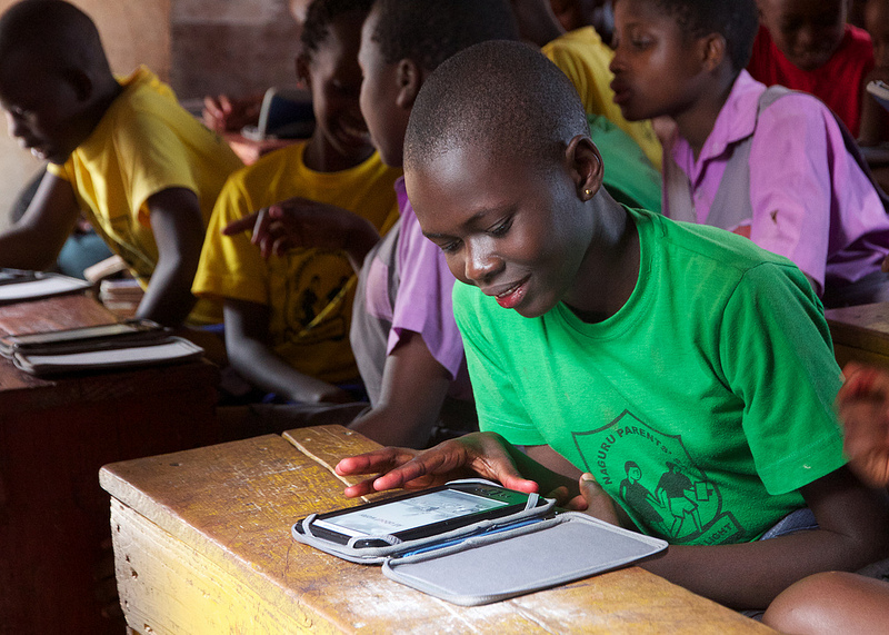 Student reading from an e-reader in Uganda. Image Credit: Worldreader